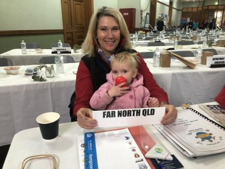 a picture of far north Qld branch member with a child on her lap